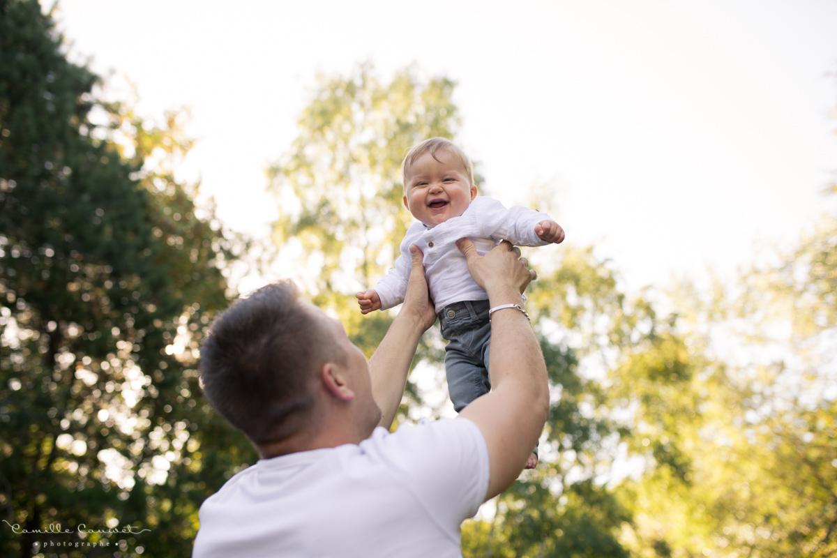 photo papa bébé rire